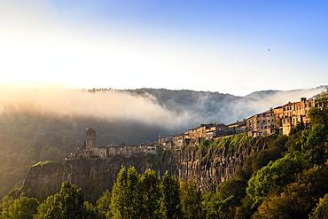 The clifftop village of Castellfollit de la Roca in the morning light, Garrotxa, Girona, Catalonia, Spain, Europe