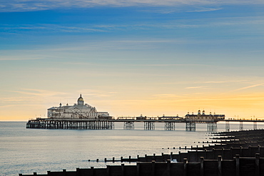 View along the beach to Eastbourne pleasure pier, Eastbourne, East Sussex, England, United Kingdom, Europe