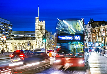 A London double-decker bus in moving traffic on Putney Bridge in the early evening, London, England, United Kingdom, Europe