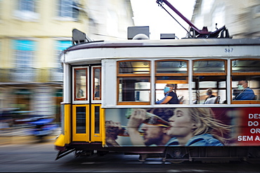 A traditional historic Remodelado electric tram moving through the centre of the city, Lisbon, Portugal, Europe