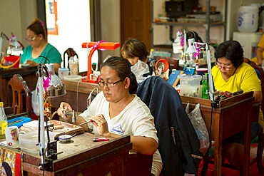 Goldsmiths working in a jewellery factory in Northern Thailand, Southeast Asia, Asia
