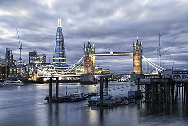 The River Thames, Tower Bridge, City Hall, Bermondsey warehouses and the Shard at night shot from Wapping, London, England, United Kingdom, Europe