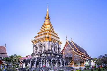 Elephant sculptures on the Chedi Chang Lom and the main bot at the temple of Wat Chiang Man, Chiang Mai, Thailand, Southeast Asia, Asia