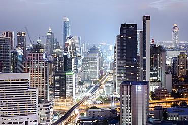 Skyline showing the Skytrain and city centre around Sukhumvit Road and Chit Lom, Bangkok, Thailand, Southeast Asia, Asia