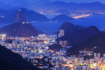 View of the Sugar Loaf and Guanabara Bay at night from Tijuca National Park, Rio de Janeiro, Brazil, South America