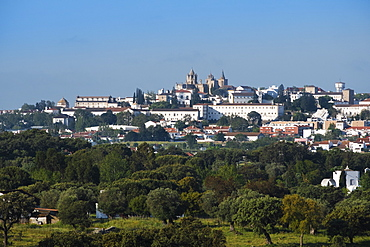 View of Evora city with cork oak fields in the foreground, Evora, Alentejo, Portugal, Europe