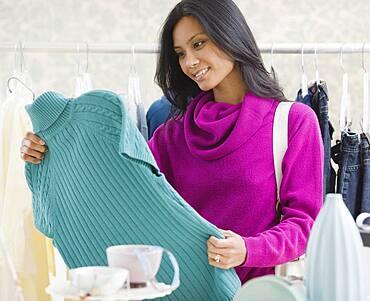 Pacific Islander woman clothing shopping