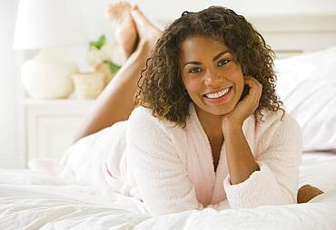 African woman laying on bed