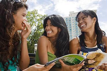 Hispanic women laughing