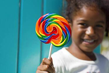 African girl holding lollipop