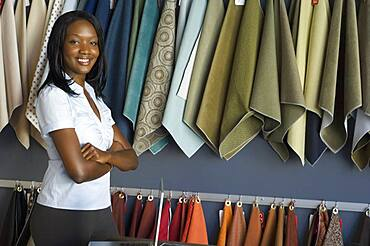African woman next to fabric swatches