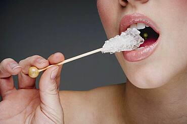 Woman eating rock candy