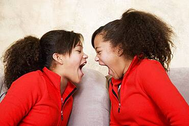 African twin sisters yelling