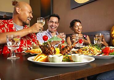 Multi-ethnic friends at restaurant