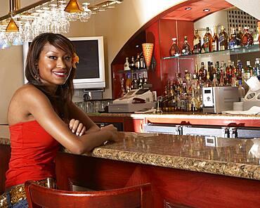 African American woman sitting at bar