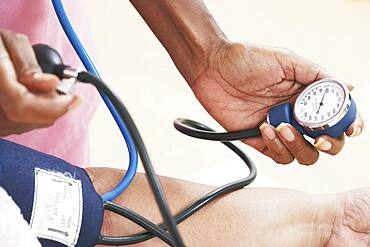 Nurse taking senior's blood pressure