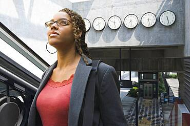 African businesswoman in train station