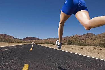 Mixed Race woman running on road
