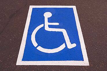 Handicapped symbol painted on pavement