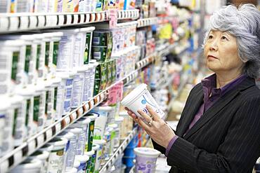 Senior Asian woman shopping in grocery store