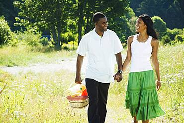 African couple carrying picnic basket