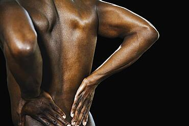African man with hands on bare back