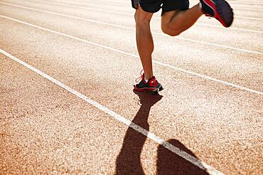 Male athlete running on a track