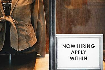 Now Hiring sign in store window