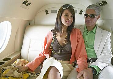 Couple sitting on private jet
