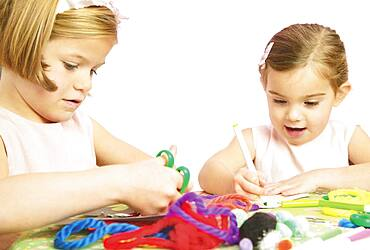 Young girls doing arts and crafts