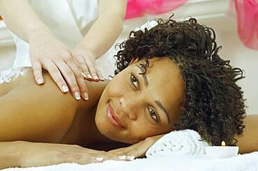 African woman receiving massage