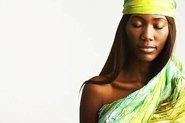 Studio shot of African woman with eyes closed