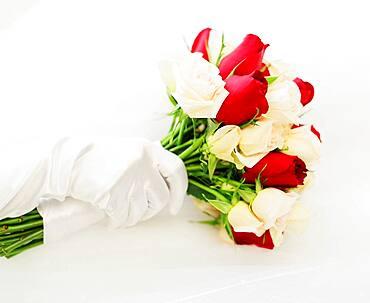 Gloved hand with wedding bouquet