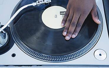 Man spinning vinyl on a turntable