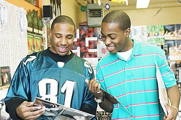 Teenage boys examining vinyl in a music store