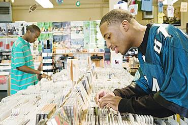Teenage boys browsing in a music store