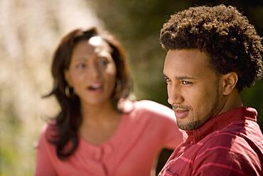 African American man ignoring girlfriend