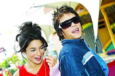 Young Hispanic couple smiling at carnival