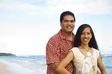Pacific Islander couple at beach