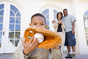 African American boy with baseball and glove