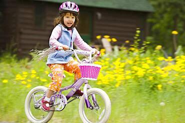 Portrait of girl riding bike