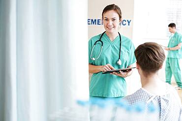 Doctor talking to patient in hospital emergency room