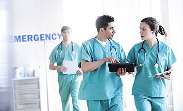 Doctors talking in hospital emergency room