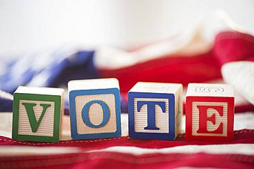 Close up of vote toy blocks on American flag