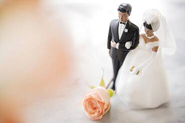 Close up of bride and groom wedding cake topper