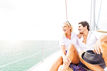 Couple hugging on deck of sailboat