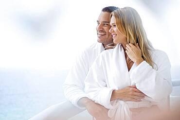Couple hugging on balcony