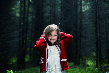 Caucasian girl smiling in forest