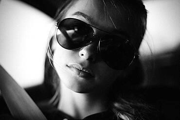 Caucasian teenage girl wearing sunglasses