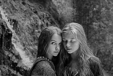 Caucasian teenage girls in forest